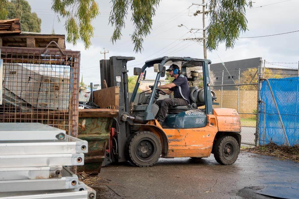 Worker Recycling Metals